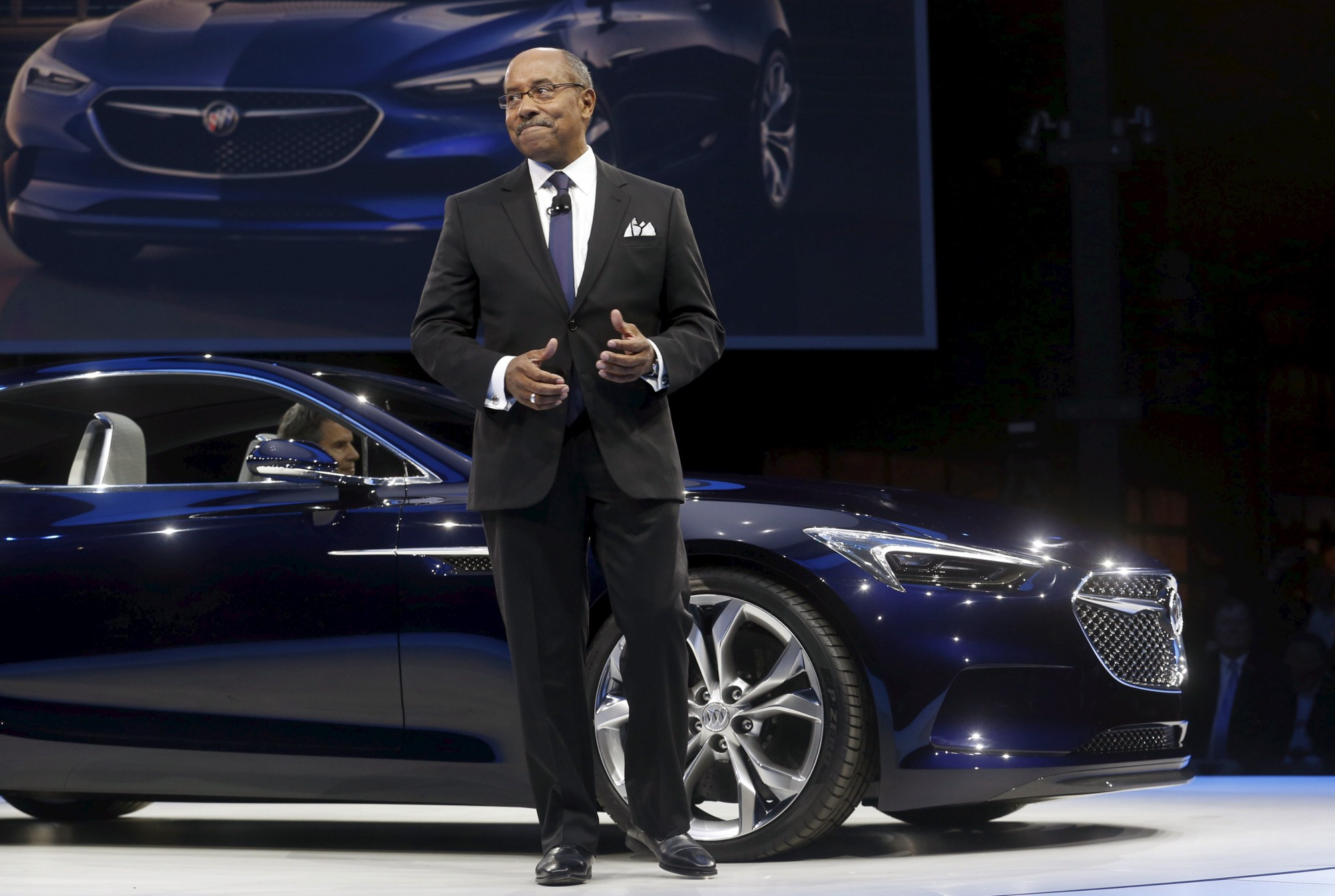 File photo of Ed Welburn talking about the Buick Avista concept vehicle after it was introduced in Detroit