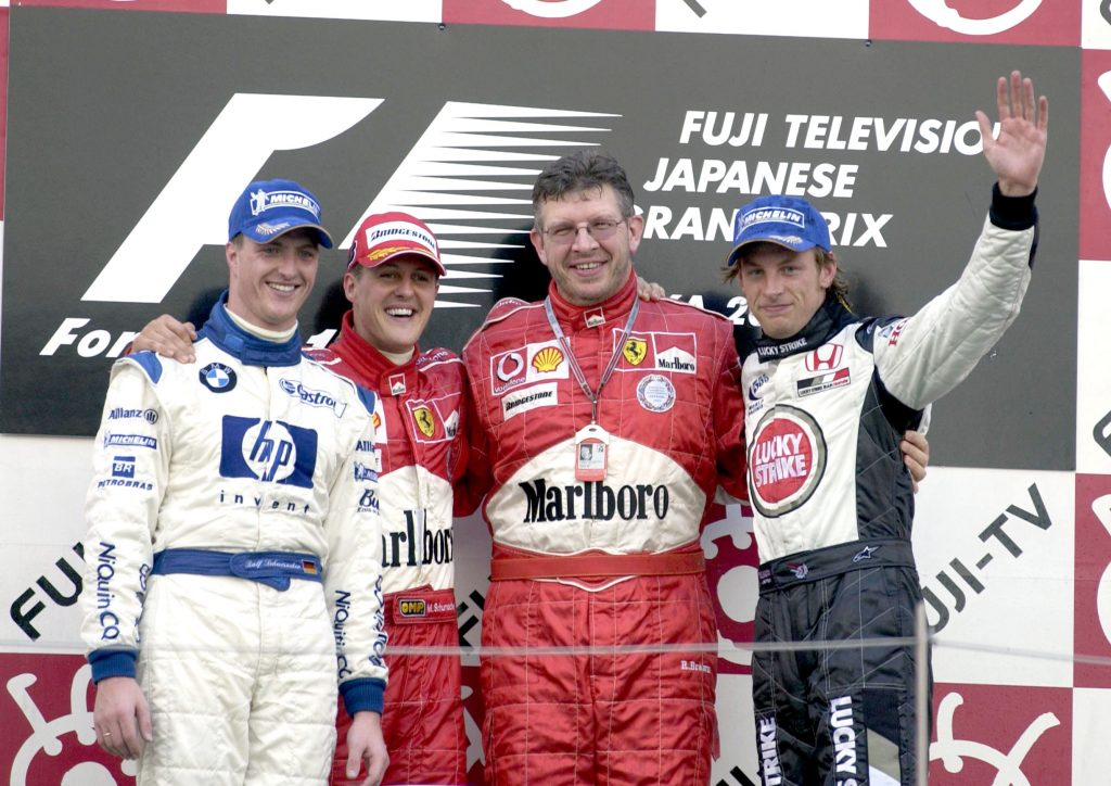 Ralf Schumacher, Michael Schumacher, Ross Brawn en Jenson Button.