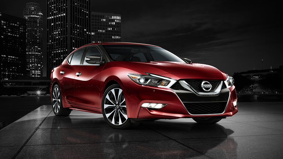 2017-nissan-maxima-coulis-red-side-view-night-skyline-large